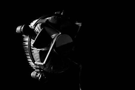 Black and white template of heatsink fan on dark background.