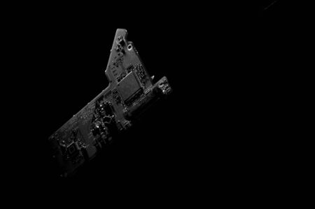 Black and white template of circuit board on dark background.