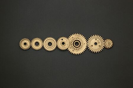 Template of golden plastic gears for industry projects or mechanics topics. Imagens
