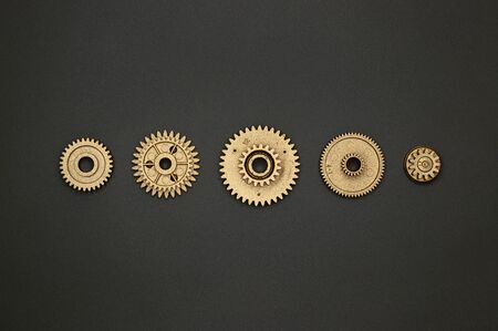 Template of golden plastic gears for industry projects or mechanics topics. 免版税图像