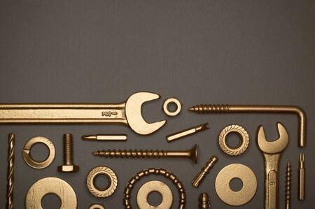 Template of golden tools on gray background for industry projects or mechanics topics.