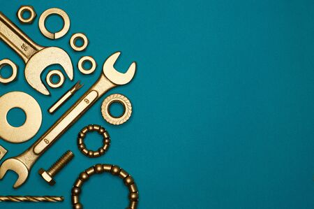 Template of golden tools on blue background for industry projects or mechanics topics.
