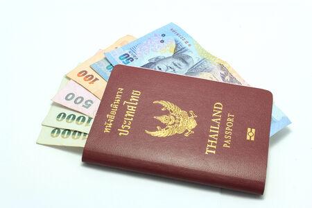 Thailand Passport and Thailand Banknotes photo
