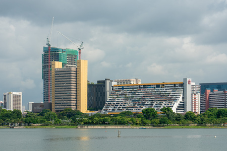 Golden Mile Complex is a high-rise commercial and residential building on Beach Road in Kallang, Singapore. The building was formerly known as Woh Hup Complex. The complex contains 411 shops and 500 parking spaces. The building, much like Lucky Plaza, is