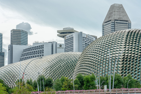 Singapore  - June 30, 2018: Esplanade theatre with Suntec City and downtown hotel in the background Editorial