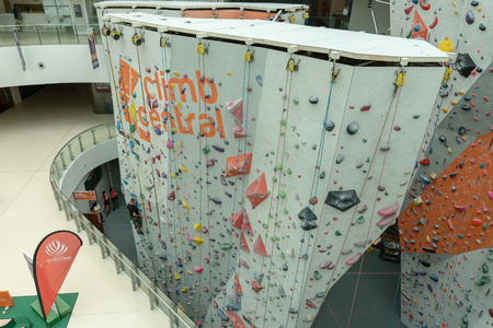 Singapore  - July 3, 2018: Climbing wall indoor in a shopping mall.