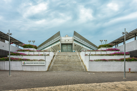 Singapore  - July 3, 2018: Indoor stadium entrance with stairs and sign in view Editorial