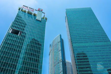 Singapore  - August 11, 2018: Green and Blue skyscrapers downtown with blue sky