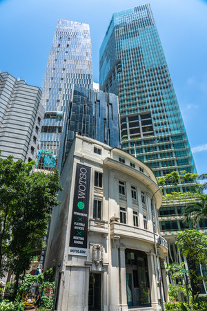 Singapore  - August 11, 2018: Old building in front of new modern tall glass buildings Editorial