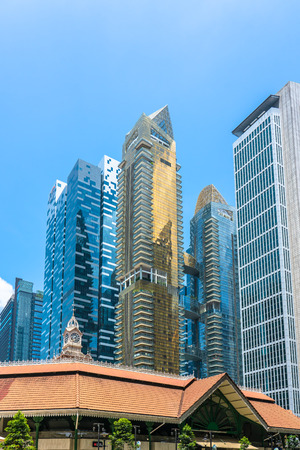 Singapore  - August 11, 2018: Condominium, financial and bank buildings with old in front