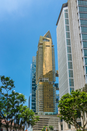 Singapore  - August 11, 2018: golden condominium with blue sky Editorial