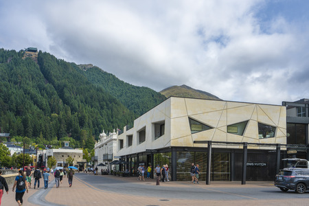 Queenstown, New Zealand - January 17, 2018: Modern building with mountain and forrest in the back