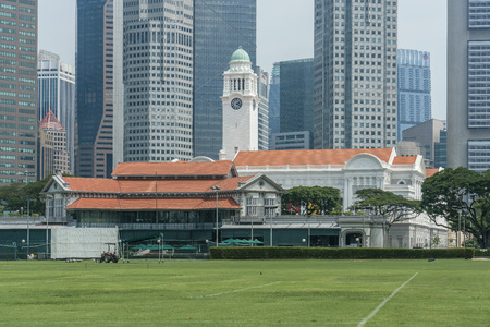 Singapore  - May 21, 2018: Singapore Cricket Club with grass lawn in front and Financial district in the back