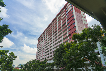 Singapore  - May 25, 2018: Rochor centre red Building with blue sky and clouds Editorial