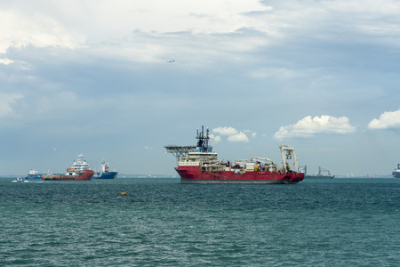 Singapore  - May 25, 2018: Vessels in the strait with cable layer ship