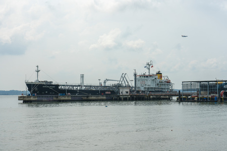 Singapore  - June 3, 2018: Tanker at the Pier in Chnagi beach Park