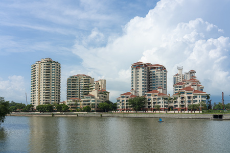 Singapore  - June 18, 2018: Condominiums by the river and blue sky with clouds behind