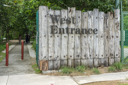 Singapore  - july 15, 2018: West Entrance sign on wood wall Editorial