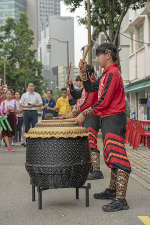 Singapore  - August 9, 2018: Dressed up drummers on a festival in Singapore Editorial