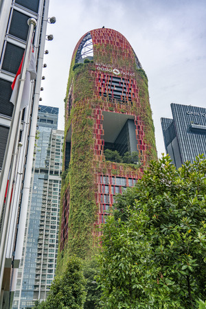 Singapore  - August 9, 2018: Hanging gardens on the red beautiful hotel