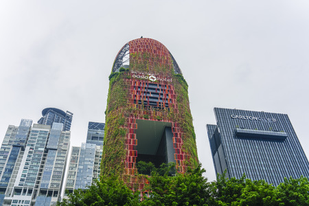 Singapore  - August 9, 2018: Hanging gardens on the red beautiful hotel in Singapore