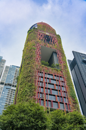 Singapore  - August 9, 2018: Hanging gardens on the red beautiful hotel from low angle Editorial