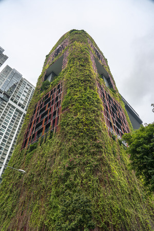 Singapore  - August 9, 2018: Hanging gardens on the red beautiful hotel, corner view
