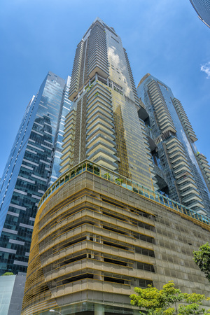 Singapore  - August 11, 2018: Blue and Golden tall buildings with blue sky