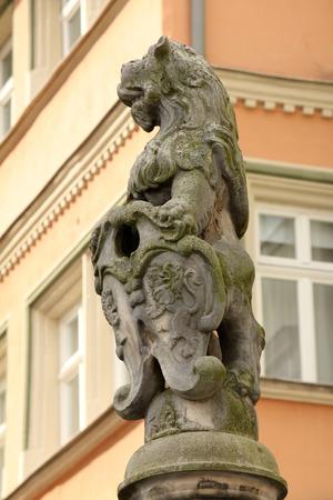 escutcheon: Heraldic lion with escutcheon  Stock Photo