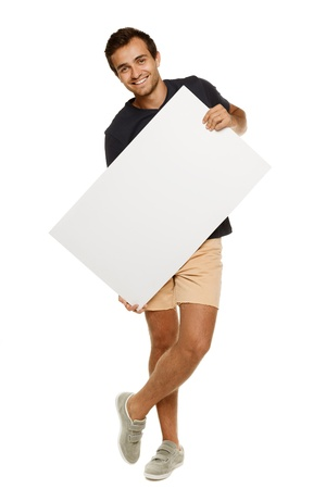 Young man in full length standing in summer casual clothing holding blank banner, over white background photo