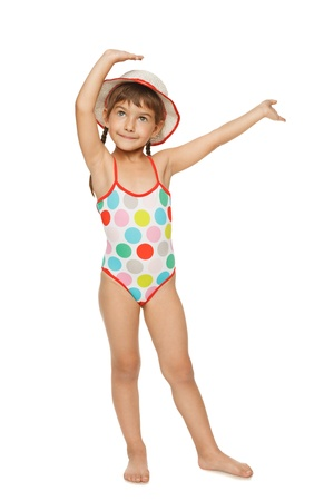 Full length of little girl in swimsuit and panama hat with hands raised, isolated over white background. Stock Photo