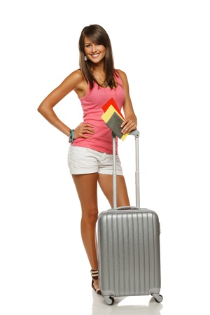 Full length of young female in casual standing with travel bag, holding passport and tickets, showing thumb up sign, isolated on white background