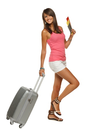 Full length of young female in casual walking with the travel bag, isolated on white background Stock Photo - 15009750