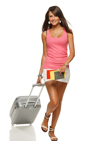 Full length of young female in casual walking with the travel bag, isolated on white background Stock Photo - 15009752