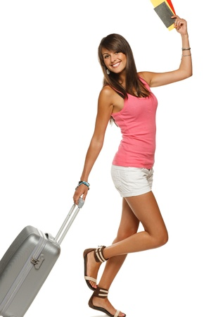 Happy young female in casual walking with the travel bag, holding passport and tickets Stock Photo