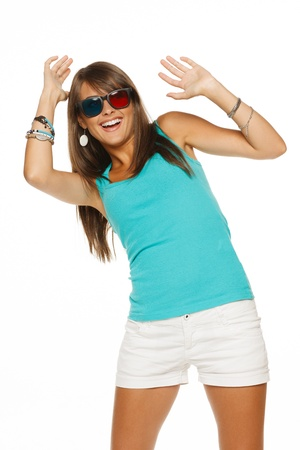 Laughing female in three-dimensional eyeglasses with hands raised, against white background photo