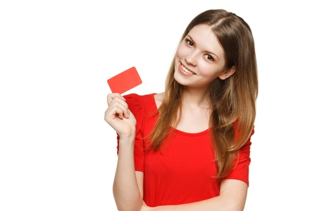 Teenager female holding empty credit card, over white background photo