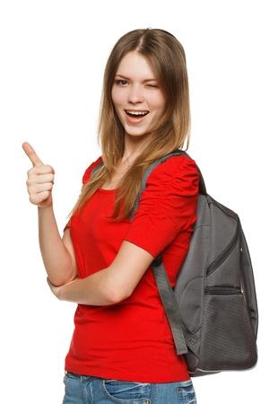 Female university student showing thumb up sign and winking isolated on white background