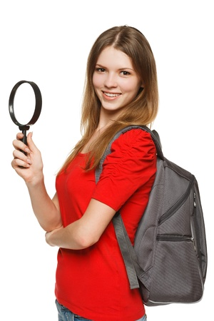 Young female student standing with magnifying glass, isolated on white background Stock Photo - 15121827