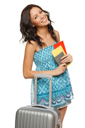 withe background: Young female in casual standing with travel bag, holding passport and tickets,isolated on withe background Stock Photo