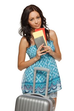 Young female in casual standing with travel bag, holding passport and tickets,isolated on withe background Stock Photo - 15165081