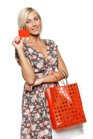 Happy shopping female holding blank credit card photo