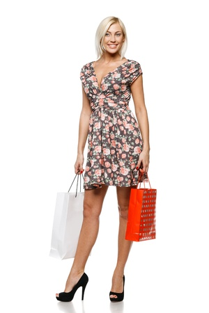Full length of a happy young woman holding shopping bags over white background Stock Photo - 15315145