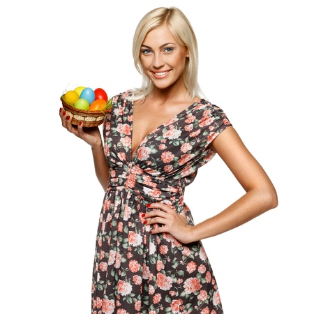Portrait of happy female holding basket with Easter eggs, isolated on white background Stock Photo - 15333862