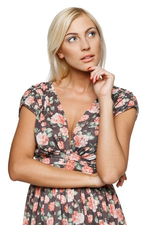 Pensive female in summer dress standing with folded hands looking away against white background Stock Photo - 15416327