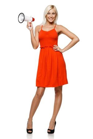 addressing: Full length of beautiful female holding loudspeaker, isolated on white background Stock Photo