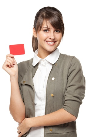 Close-up portrait of young smiling business woman holding credit card isolated on white background photo