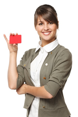 discount card: Close-up portrait of young smiling business woman holding credit card isolated on white background