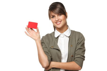 discount card: Young smiling business woman holding credit card isolated on white background