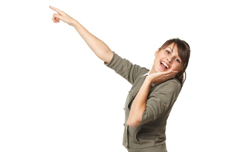 astonished: Surprised young female pointing at copy space, over white background